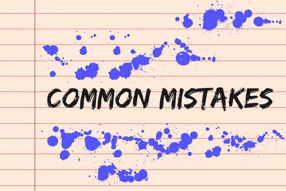 Common mistakes concept on lined paper with blue stains